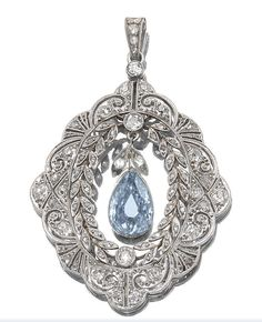 FANCY GREYISH BLUE DIAMOND AND DIAMOND PENDANT, CIRCA 1910.  The open work pendant set at the centre with a fancy greyish blue pear- shaped diamond weighing 1.03 carat, within a delicate garland style frame of stylized foliate, palmette and scroll design, set with cushion-shaped and rose-cut diamonds.