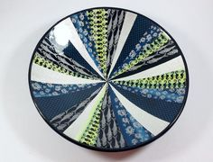 """Fish bowl. Bowl is 260 mm (10"""") diameter and 50 mm (2"""") tall. It is all polymer construction. By Wendy Jorre de St Jorre."""