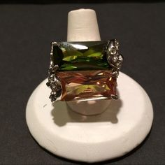 Large & Heavy Green & Amber Silver Tone Ring This ring is huge & heavy with one green stone & one Amber stone surrounded with CZ's set in silver tone.  Never worn. Jewelry Rings