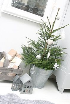 love the tree in the galvanized tin bucket with just a few ornaments.
