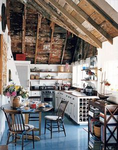 This kitchen has character! Designer Gary McBournie studied vintage boating posters and old photographs to create this eclectic look.