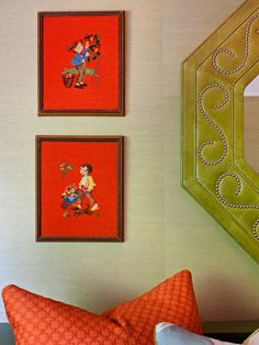 A sense of history in a child's room helps honor his or her family's past. To add personal touches, it's nice to mix old with new. Above the bed in this children's room is a handed-down embroidered art piece. It not only serves as a nod to older generations but it carries the accent color, orange, throughout the room.