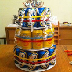 """Beer cake"" Super easy! 12"", 8' and 6' cake circles and 30 beers are all you need! Simply stack and then decorate."