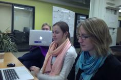 Anna and Clare brush up data visualization as they prep for the first-ever Socrata-thalon. Engineer John looks on, offering creepy eyes and bits of advice.