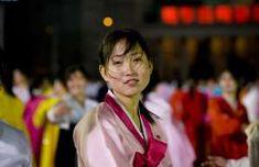 Girl At Mass Dancing In Pyongyang, North Korea - - Eric Lafforgue/Getty Images