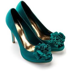 """Kind of a teal green color with ruffled """"flower"""" on the pumps."""