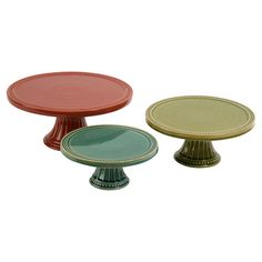 Display your culinary creations in classic style on this set of 3 multicolor ceramic stands, or set them on the vanity to corral lotions and cosmetics.