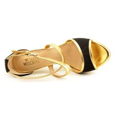 "Love Moschino JA1603BC0XJE100A Women US 7.5 Gold Sandals EU 37.5. The style name is JA1603BC0XJE100A. The style number is JA1603BC0XJE100A. Brand Color: Black/Gold (Main Color: Gold). Material: Leather. Measurements: 4.5"" heel. Width: B(M)."