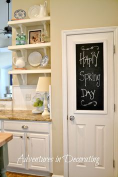 Adventures in Decorating: Spring Kitchen Shelves -  I like the chalk board inset on the door, would be good on the door to the pantry/broom closet fro reminders and notes.