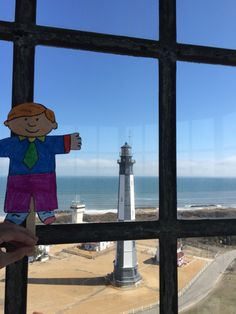 View from old Cape Henry light house to see the Atlantic ocean and new Cape Henry light house with Flat Stanley.