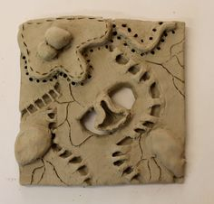 Miss Allen's Year 7 Students work from Princess Helena College. A 'Cells and Bacteria' clay tile.