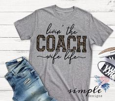 Livin the Coach Wife Life T-shirt, Football Raglan, High School Football, Sunday Football - All listed shirts are unisex, which is a looser fit-more like Men's fit except for the oatmeal wh - Football Coach Wife, Football Mom Shirts, High School Football, Sports Shirts, Baseball Mom Shirts Ideas, Cheer Coach Shirts, Football Moms, Team Shirts, Basketball Shirts For Moms