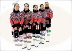 Greenland Inuit ladies in traditional netted bead shoulderpieces and lace/embroidered costumes.