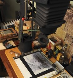 A selection of darkroom equipment including rolls of original filmstock and developing chemicals and even a pair of the famed photographer's spectacles