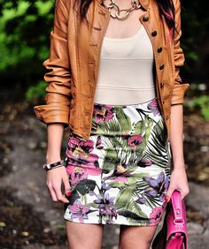 Leather jacket paired with a floral print skirt. Perfect for summer