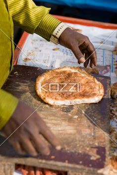 man and bread - A man handles a peice of bread in Bangalore, India