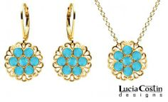 14K Yellow Gold over .925 Sterling Silver Pendant and Earrings Set Designed by Lucia Costin with Filigree Elements, Crafted with Turquoise Swarovski Crystal Flowers Lucia Costin. $104.00. Style takes wings in this lovely jewelry set that have a graceful flower shape. Handmade in USA unique jewelry set. Ornate with turquoise Swarovski crystals. Lucia Costin delicate set of jewelry. Splendid combination of dangle elements