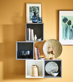 Open wall cabinets display decorative items and artwork.