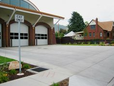 Trex Fencing at a Fire Station! Trex can be used for residential, government, even commercial purposes and exceed expectations! Trex Fencing, Fence, Exceed, Garage Doors, Commercial, Canning, Outdoor Decor, Home Canning, Carriage Doors