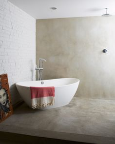 Slideshow: Modern Brooklyn Row House Renovation | Dwell (The concrete floor of the bedroom extends into the the minimalist wet room. The centerpiece of the bathroom is the MTI standalone tub.)