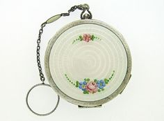 Art Deco guilloche enamel compact with chain and finger ring. Sterling. Roses. $295.00, via Etsy.
