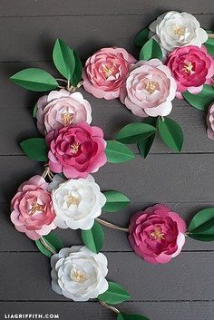 Paper Flowers | 31 Free Wedding Printables Every Bride-To-Be Should Know About My mom's friend's daughter made these for another wedding, and they were apparently gorgeous!