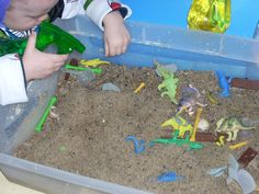 dinosaurs erosion in a tote.  would be cool to use the dinosaur egg mix and make awhole tote of it.  then instead of using a spray bottle on the sand they can use their toy hammers and chisls or screw drivers to chip away and find te treasures,