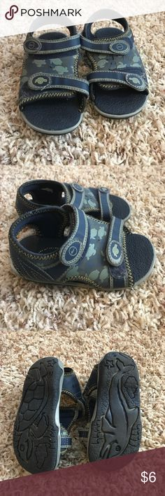 Stride rite sandals Cute little sandals. Prefect for beach wear. Velcro on with ankle strap. Some cracking on top. Great condition to just run around in. My kid loved the turtles on them. Stride Rite Shoes Water Shoes
