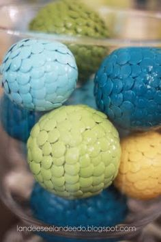 Put thumb tacks on styrofoam balls and spray paint whatever colors you want. Dragon eggs.
