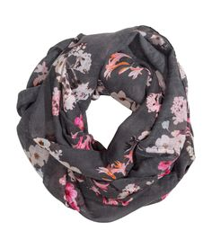 Look ahead to warmer days with this dark gray floral infinity scarf. | H&M Accessories