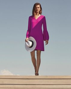 Have a magenta day (and night). Our Bell-Sleeve Dress is an effortlessly elegant shift featuring of-the-moment bell sleeves. With built in drama like that, just add some strappy sandals and a chic straw hat. Done and done.