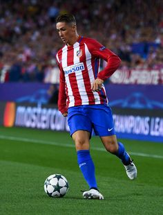 Fernando Torres Photos Photos - Fernando Torres of Club Atletico de Madrid runs with the ball during the UEFA Champions League Group D match between Club Atletico de Madrid and FC Bayern Muenchen at Vicente Calderon Stadium on September 28, 2016 in Madrid, Spain. - Club Atletico de Madrid v FC Bayern Muenchen - UEFA Champions League