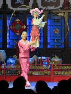 A puppeteer manipulates a traditional Sichuan puppet at the Shufengya Yun Teahouse in Chengdu, China. Chengdu, Puppet, Opera, China, Traditional, Opera House, Porcelain, Porcelain Ceramics