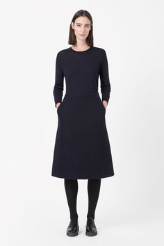 Made from boiled wool with a soft, tactile finish, this long skirt has a metal zip fastening along the back. Designed to sit on the waist and flaring towards the hemline, it has slanted side seams, front pockets and cleanly finished edges.