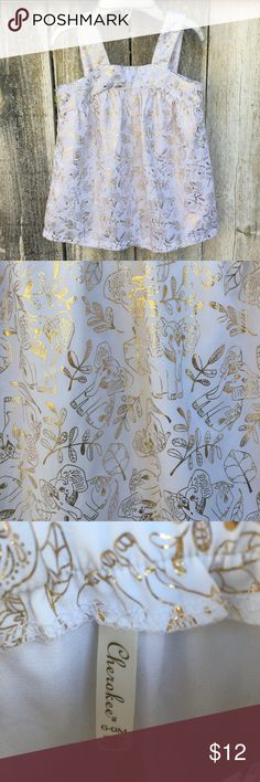 Baby Gold Elephant Tunic Like New   Super cute Gold elephant print tunic for baby! Great for summer! Can be dressed up or down!   Bundle for additional discounts! Cherokee Bottoms Jumpsuits & Rompers