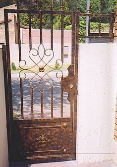 Wrought Iron Courtyard Gates   Wrought Iron-Center Design Wrought Iron Gate Designs, Wrought Iron Gates, Burglar Bars, Gate Decoration, New Home Wishes, Security Gates, Courtyard Entry, Bathroom Countertops, Front Entrances