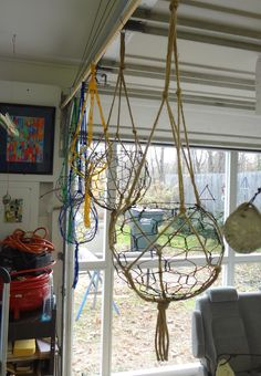 Some of my wire baskets with handmade macrame hangers.