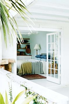 The best bedrooms of 2016: Complete with 1920s charm and surrounded by the natural elements, this Palm Beach bedroom is one of our favourites. With spilling French doors and reclaimed wood accents, the bedroom evokes desires of waking up refreshed every morning. See the whole house tour here. Image credit: Prue Ruscoe