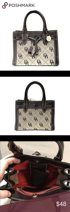 "Dooney & Bourke Monogram Mini Handbag Dooney & Bourke canvas monogram & leather small handbag Chocolate brown leather & Tan canvas 6.5""x8.75"" 4"" handle drop Dooney & Bourke Bags Mini Bags"