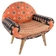 Crafted from mango wood and featuring vintage cotton kantha cloth upholstery, this eye-catching arm chair adds a bohemian pop of color to your living room or...