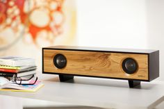 tabletop HIFI from designers Blake Tovin and Matt Richmond. comes in a variety of colors and finishes. pictured:  jet black and solid oak, i believe