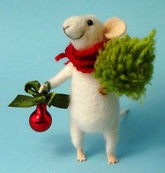 This adorable little felted mouse was hand made from merino wool and decorated with embroidery. The red scarf makes this little guy quite dashing, don't you think?  Image courtesy of https://www.etsy.com/listing/214248628/needle-felted-mouse-christmas-mouse?ga_order=most_relevant&ga_search_type=all&ga_view_type=gallery&ga_search_query&ref=sr_gallery_4