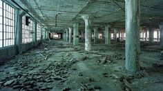 """Creepy Images of What Uninhabited World Would Look Like - Ruins of Detroit: Frightening Remnants of a Lost World - Yves Marchand and Romain Meffre spent five years documenting the disintegration Detroit in their project, """"The Ruins of Detroit"""". - I just don't understand why books are left behind in an old library or records are left behind in an old police station."""