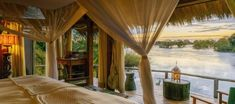 Riverside romance in Zambia ✨ - These gorgeous cabanas can be found on a private island near the world-famous Victoria Falls and feature top-notch amenities and spectacular views. - Learn more about this incredible accommodation by clicking the link Luxury Accommodation, Luxury Lodges, Luxury Glamping, Victoria Falls, Safari, Island, Places, Camps, Travelling