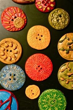 Making buttons from polymer clay and holes made with tooth pick