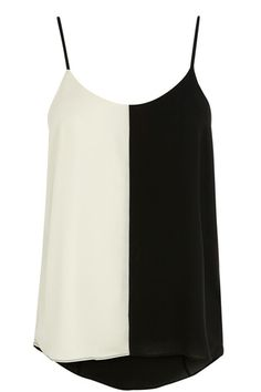 We love this classic monochrome camisole with its round neckline, dip back hem and adjustable shoe string straps.