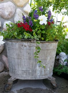 Old mop bucket planter