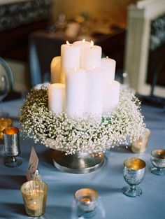 Baby's Breath and Candle Centerpiece - A wreath of baby's breath makes the perfect base for your centerpiece of candles, or even in larger scale at the base of your cake!