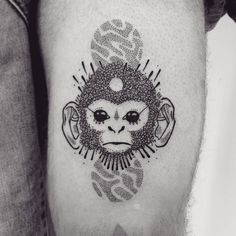 Capuchin monkey tattoo on the left thigh.