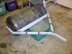 Lawn Roller by Chris Eigenheer -- Homemade lawn roller constructed from a surplus heater tank, treadmill frame, and CRS bar stock. http://www.homemadetools.net/homemade-lawn-roller-3